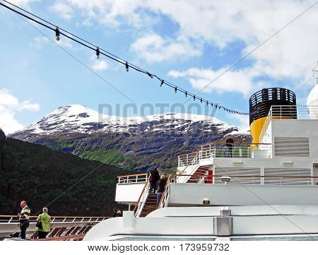 Geiranger, Norway - June 3, 2009: The cruise ship Costa Magica of Costa Cruises travels in the morning on the Geirangerfjord in Norway.