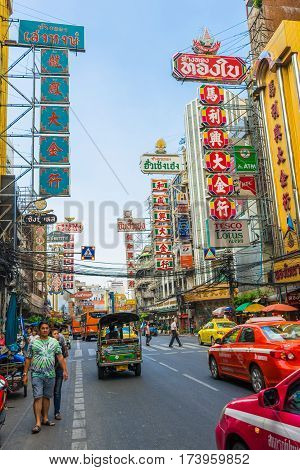 Bangkok Thailand - November 23 2014 : Bright signs of the stores restaurants and car on china town (Yaowarat) Road once of Bangkok landmark street for more foods for thai-chinese style.