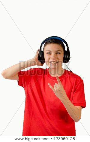 Teenage boy listening to music making a rock n roll hand gesture