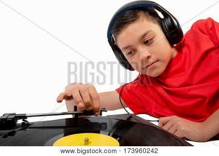 Teenage boy putting the needle on a LP