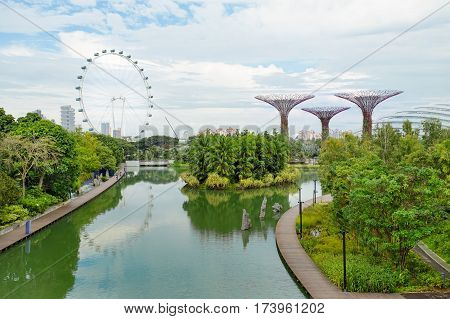 MARINA BAY SINGAPORE - JAN 20 2017: Landscape of Gardens by the bay Supertree grove and Singapore flyer in Singapore.