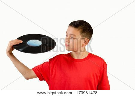 Teenage boy looking at a LP in his hand