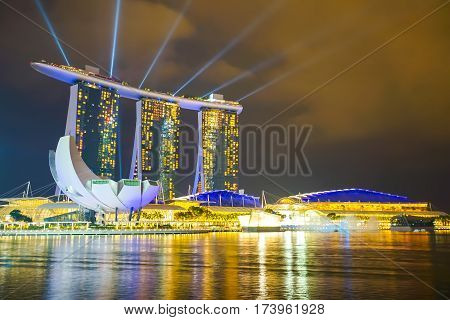 MARINA BAY SINGAPORE - JAN 20 2017: Landscape of the Marina Bay Sands laser show in Singapore.