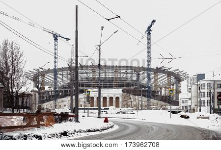 Ekaterinburg Russia - 02.03.2017: Old Central Stadium rebuilt for Soccer World Cup in 2018. The intersection of streets of Malyshev and Repin at overcast winter day.