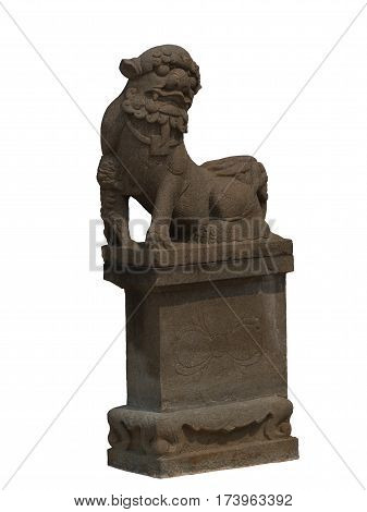 The stone sculpture of a lion gate guardian of the temple
