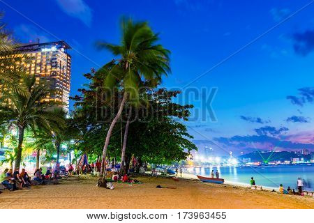 PATTAYA THAILAND - JANUARY 27: This is city Pattaya beach at night with the Hilton hotel. Many tourists come to this part of the beach at night to sit and relax on January 27 2017 in Pattaya