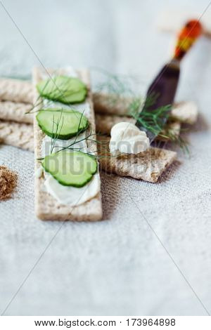 Stack of crispbreads with cream cheese