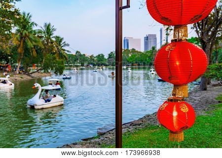 Chinese new year decorations with Lumpini park out of focus in the background