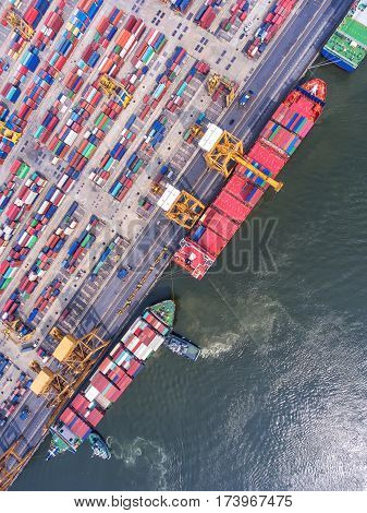 container ship in import export and business logistic.By crane Trade Port Shipping.cargo to harbor.Aerial view.Water transport.International.Shell Marine.Top view.