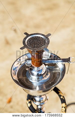 Big Hookah For Tobacco Made Of Metal, Glass And Ceramics. Shine. Sunny Day