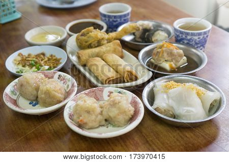 Dim sum the first meal of the day for Chinese breakfast style mixed of Chinese cuisine prepared as small bite-sized portions of food served on small plates