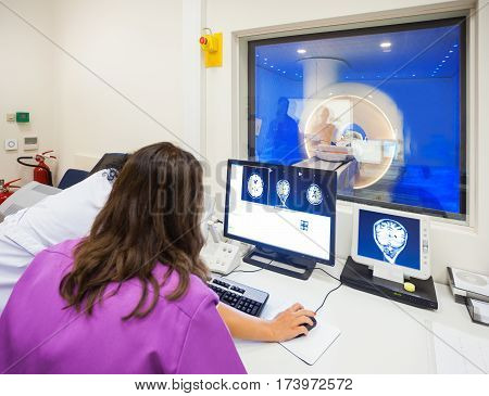 Operators are looking at images of MRI scanned human brain in modern hospital.
