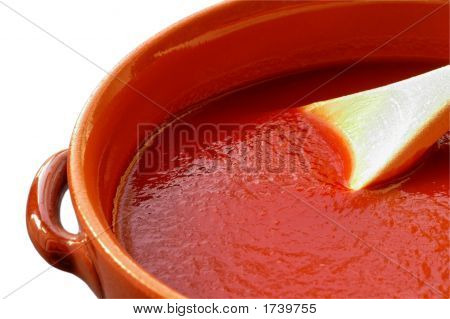 Terracotta Pot And Wooden Spoon With Tomato Sauce.With Clipping Path