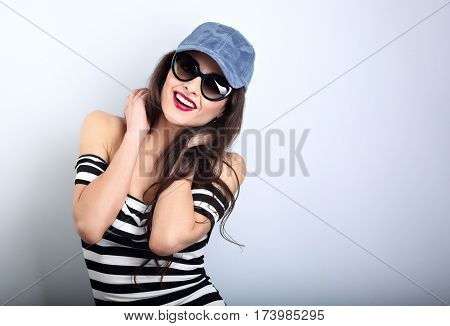 Happy Enjoyment Young Woman In Sunglasses And Blue Baseball Cap Posing And Looking In Striped Blouse
