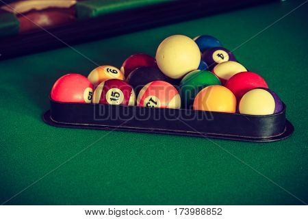 Billiard cue balls on green table. Pool game