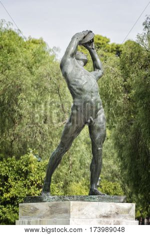 ATHENS, GREECE, SEPTEMBER 8, 2016: Statue of Discobolus throwing disc at the entrance of Panathenaic Stadium, Athens, Greece