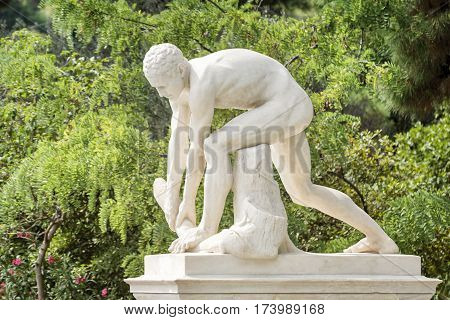 ATHENS, GREECE, SEPTEMBER 8, 2016: Statue of Wood Chopper in front of Panathenaic Stadium on Vassilis Konstantinos Avenue, Athens, Greece.