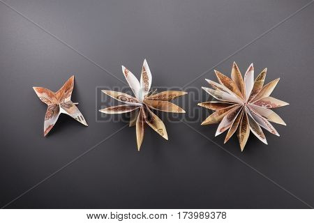 flowers origami banknotes on a dark background