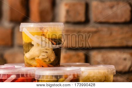 Food preserving for autumn winter time. Containers with pickled vegetables in cellar.