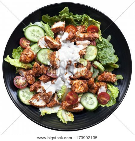 Tandoori chicken salad, top view on black plate isolated on white.