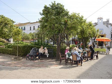 MARBELLA, SPAIN - FEBRUARY 27, 2017: People at the Orange Tree Square in the historic center of Marbella a city of the province of Malaga Andalusia Spain.