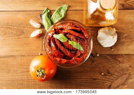 Italian appetizer - sundried tomato in bowl on the wooden table.