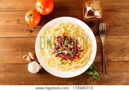Italian dish - pasta with sundried tomato and basil. Top view.