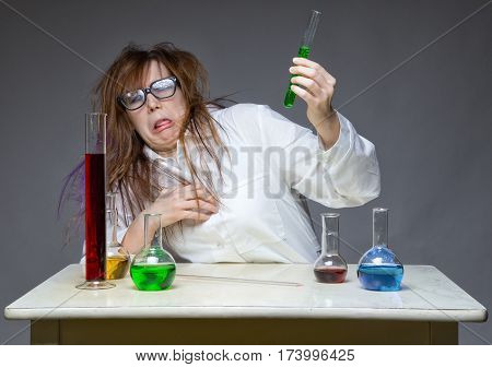 Disgust and messy scientist in lab on gray background
