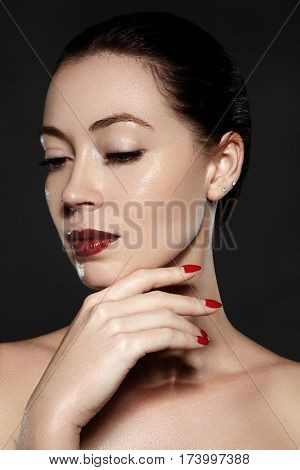Cosmetics, Manicure On Nails With Bright Red Polish. Dark Red Lips Make-up And Nail Color