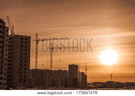 New of multi-storey building and high crane/Building of new houses and tower cranes