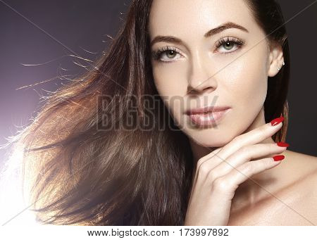 Beautiful young woman model with flying brown color hair. Beauty portrait with clean skin glow glamour fashion makeup. Make up curly hairstyle. Haircare make-up. Horizontal beauty portrait poster