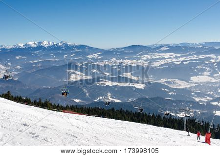 Chair Lift On The Top Of Ski Slope Of Skiing Park Kubinska Hola In Winter.