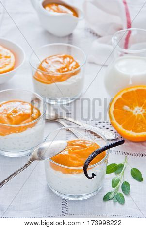 Rice pudding with vanilla and orange custard
