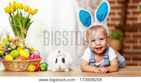 happy easter! happy funny baby boy playing with Easter bunny