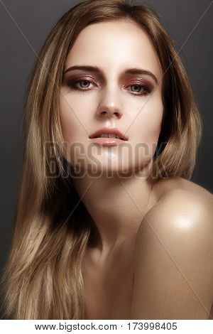 Beautiful Young Woman With Gloss Eyes And Lips Visage. Beauty Clean Skin, Fashion Makeup. Cosmetics,