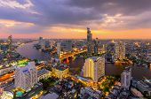 Aerial view of Bangkok modern office buildings condominium living place in Bangkok city downtown with sunset scenery Bangkok is the most populated city in Southeast Asia.Bangkok Thailand poster
