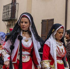 Oristano Sardinia Italy - February 17 2015: Women in Sardinian costume ride in Oristano during the festival of Sartiglia. Oristano Sardinia Italy.