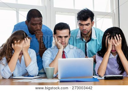 Employees Of An Insolvent Startup Company At Office