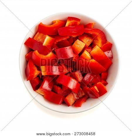Chopped Red Pepper In Bowl Isolated On White Background. Top View.