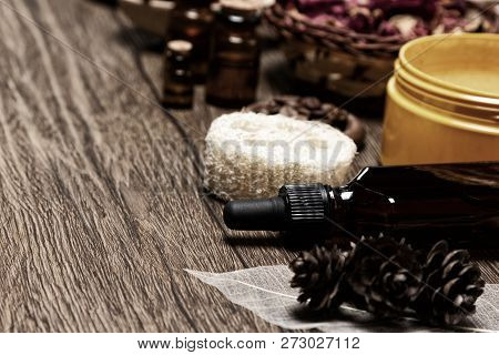 Skin Care Products And Natural Essential Oils On Wooden Table. Spa And Aromatherapy Background With