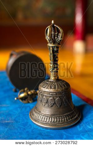 Buddhist religious equipment - Vajra Dorje and bell. Close up view in tibetan buddhist monastery in Ladakh