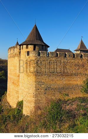 Close-up View Of High Stone Wall With A Tower Of Medieval Khotyn Castle. Autumn Landscape View.  Kho