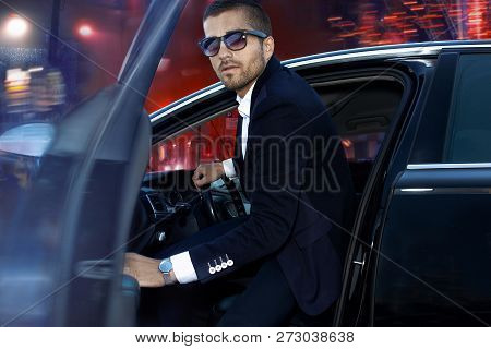 Businessman Driving At Night In The City, Life Luxury Man In The Car