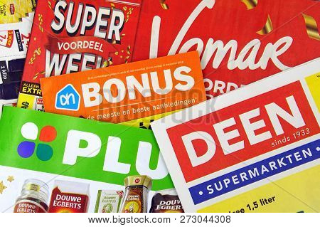 Amsterdam, The Netherlands - December 9, 2018: Stack Of Grocery Shop Sale Flyers Or Advertising Broc