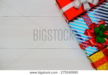 Christmas And Happy New Year Composition, Golden Christmas Present Gift Boxes With Red Ribbon On Woo