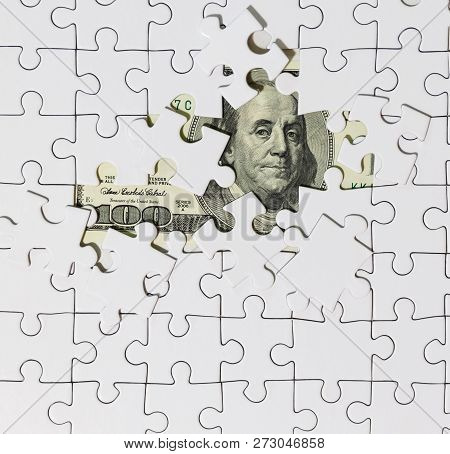 Background Of White Puzzle In The Center Of Which The Banknote In 100 Dollars