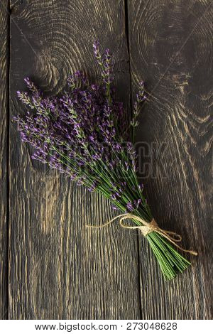 Fresh, Fragrant Bouquet Of Lavender On A Background Of Dark Boards