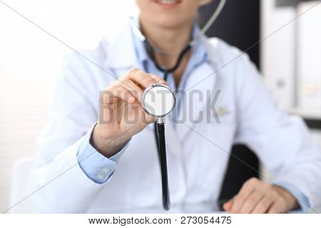 Doctor Holds Stethoscope Head, Closeup. Physician Ready To Examine And Help Patient. Medical Help An