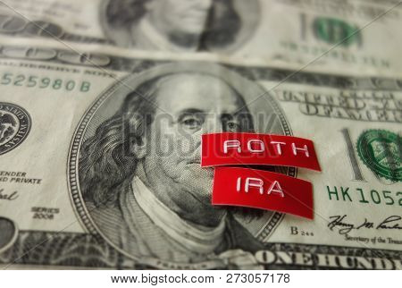 Roth IRA label on a hundred dollar bill poster