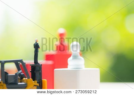 Miniature People Businessman Standing On Toy Yellow Forklift Miniature Ready To Business Negotiation